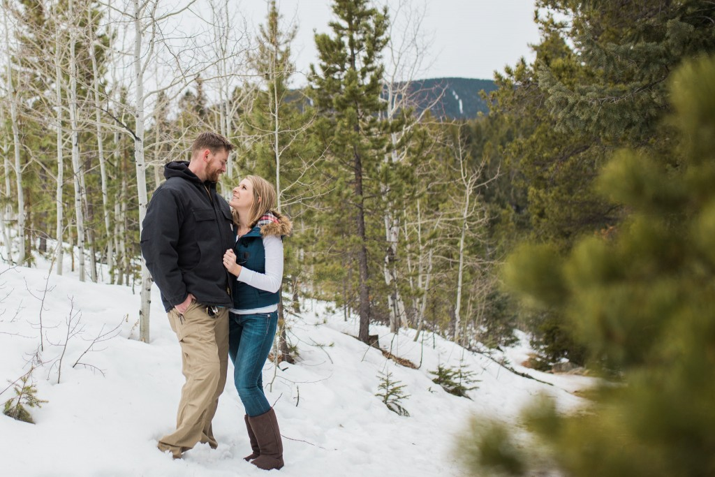 Lovely couple taking engagement photos in Conifer Colorado in January