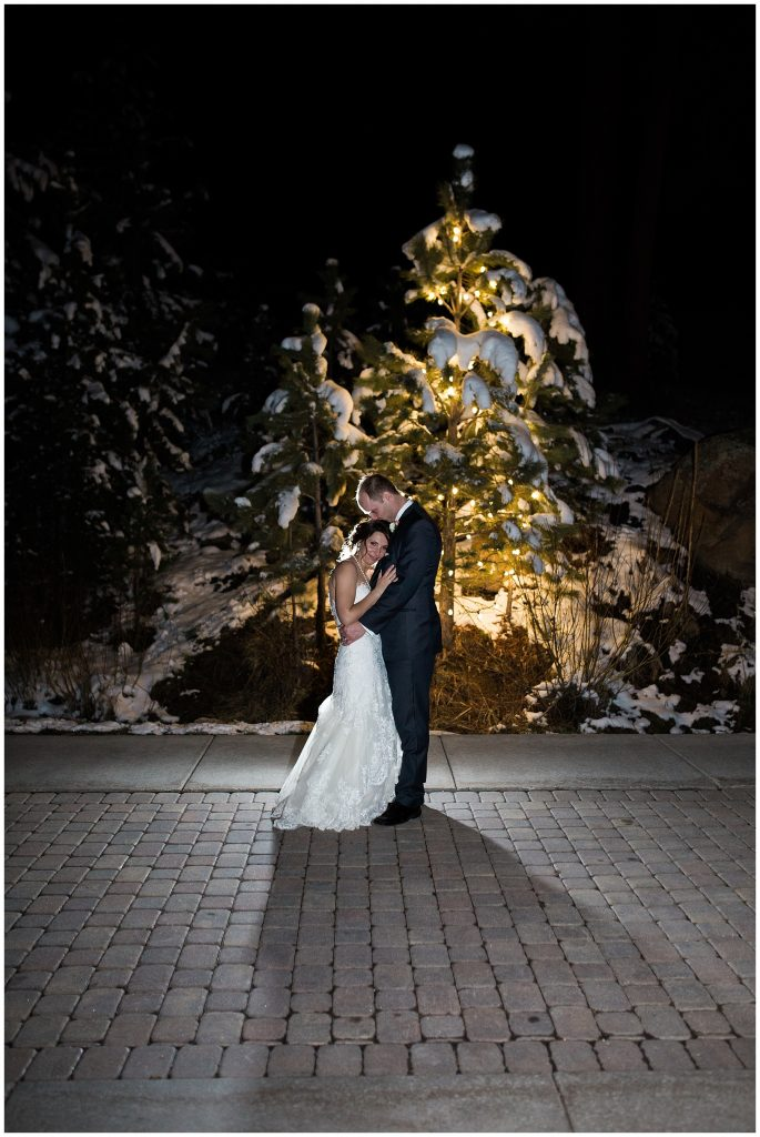Bride and groom brave the cold for an outdoor photo in Estes Park